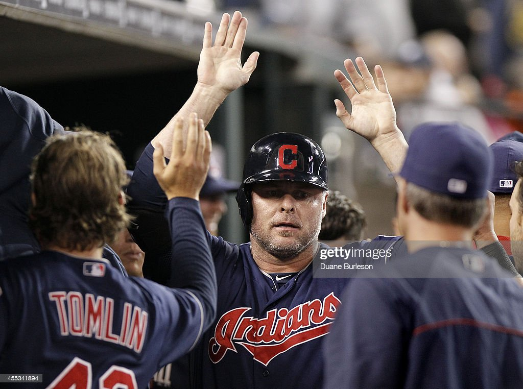 Jason Giambi of the Cleveland Indians celebrates after scoring from first base on a double by Lonnie Chisenhall during the ninth inning of a game...