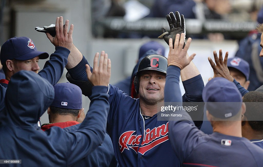 Jason Giambi #25 of the Cleveland Indians is greeted in the dugout after hitting a solo home run during the second inning against the Chicago White Sox at U.S. Cellular Field on May 28, 2014 in Chicago, Illinois.