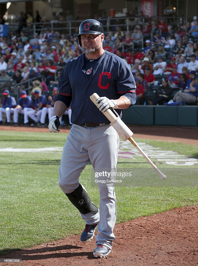Jason Giambi of the Cleveland Indians prepares for an at bat during a spring training baseball game against the exas Rangers on March 3 2014 in...