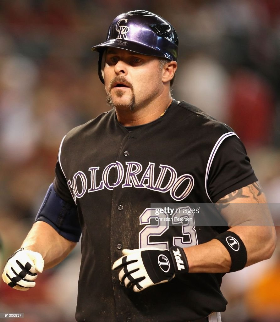Jason Giambi of the Colorado Rockies crosses home plate after hitting a 2 run home run during the major league baseball game against the Arizona...