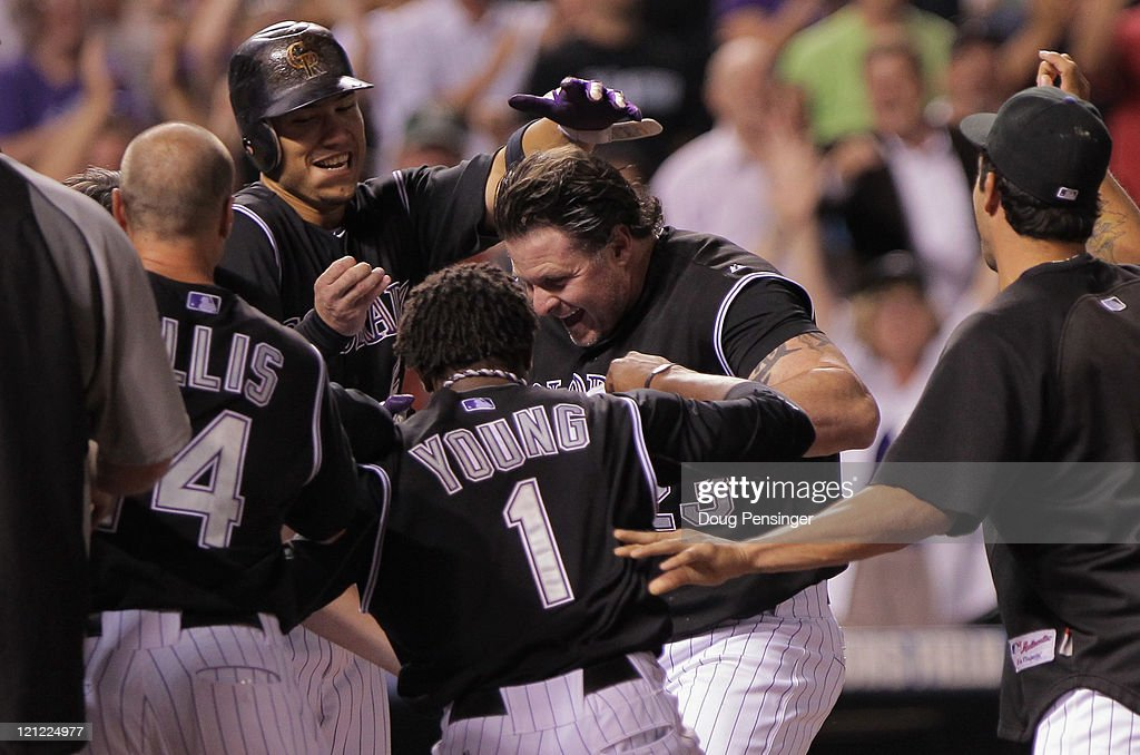 Jason Giambi of the Colorado Rockies is welcomed home as the Rockies celebrate his game winning walk off home run off of pitcher Randy Choate of the...