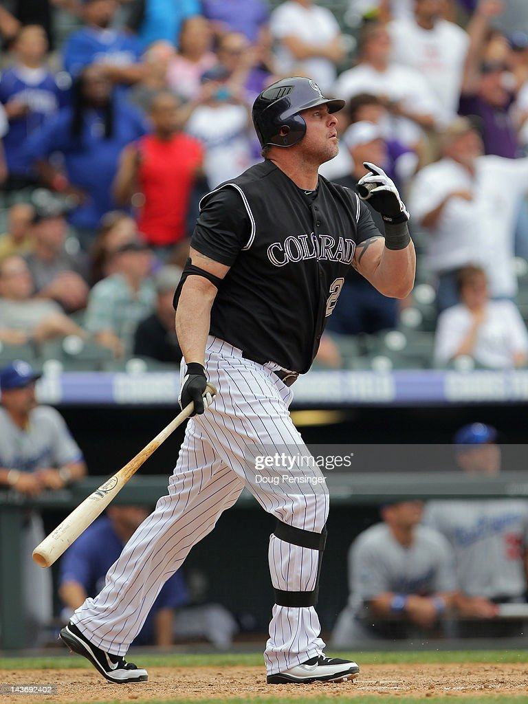 Jason Giambi of the Colorado Rockies watches his game winning three run pinch hit walk off home run off of Scott Elbert of the Los Angeles Dodgers at...