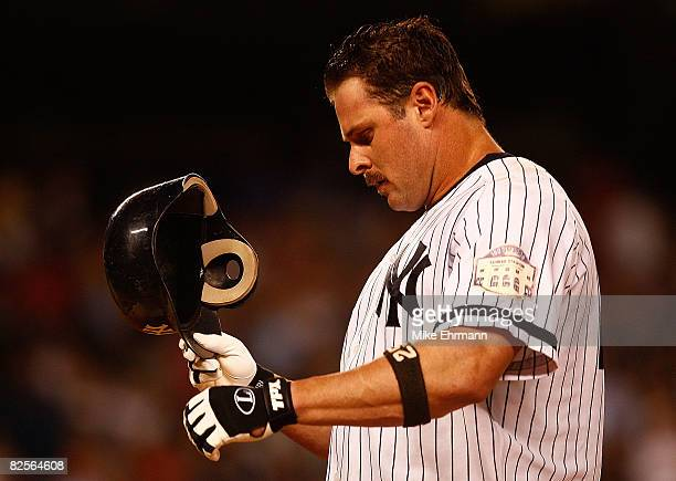 Jason Giambi of the New York Yankees reacts after flying out against the Boston Red Sox on August 26 2008 at Yankee Stadium in the Bronx borough of...
