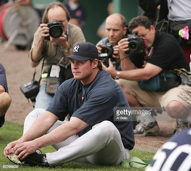 Jason Giambi of the New York Yankees stretches in front of photographers before their preseason game against the Boston Red Sox on March 7 2005 at...