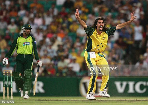 Jason Gillespie of Australia celebrates taking the wicket of Azhar Mahmood of Pakistan during game two of the best of three finals of the VB Series...