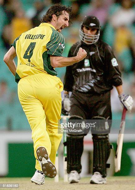 Jason Gillespie of Australia celebrates taking the wicket of Matthew Sinclair of New Zealand during game two of the ChappellHadlee Trophy between...