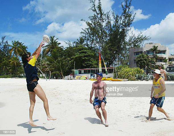 Jason Gillespie of Australia plays touch rugby on the beach on April 25 2003 in Bridgetown Barbados