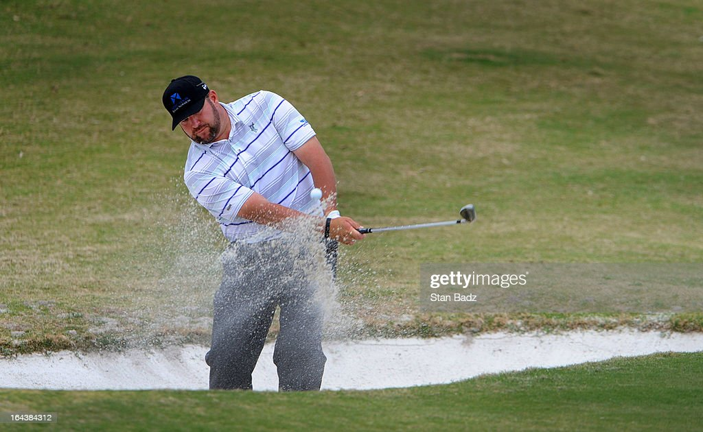 <a gi-track='captionPersonalityLinkClicked' href=/galleries/search?phrase=Jason+Gore&family=editorial&specificpeople=217228 ng-click='$event.stopPropagation()'>Jason Gore</a> hits from a bunker on the fifth hole during the third round of the Chitimacha Louisiana Open at Le Triomphe Country Club on March 23, 2013 in Broussard, Louisiana.