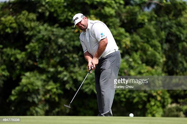 Jason Gore of the US putts on the 13th hole during round one of the CIMB Classic at Kuala Lumpur Golf Country Club on October 29 2015 in Kuala Lumpur...