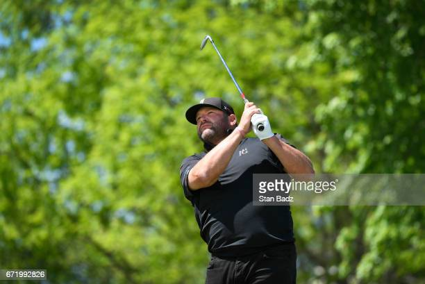 Jason Gore plays a tee shot on the seventh hole during the final round of the Webcom Tour United Leasing Finance Championship at Victoria National...