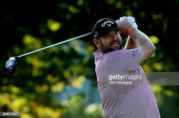 Jason Gore plays his shot from the first tee during the first round of the Sony Open In Hawaii at Waialae Country Club on January 14 2016 in Honolulu...