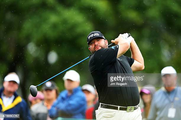 Jason Gore plays his shot from the third tee during the final round of the Travelers Championship at TPC River Highlands on June 28 2015 in Cromwell...