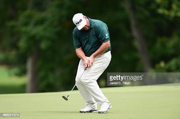 Jason Gore reacts after missing his birdie putt on the third green during the final round of the Wyndham Championship at Sedgefield Country Club on...