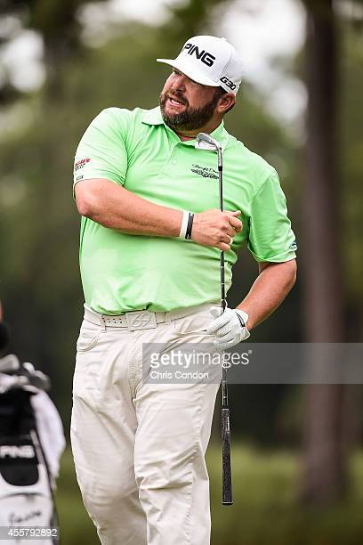 Jason Gore reacts to his tee shot on the second hole during the third round of the Webcom Tour Championship at TPC Sawgrass Dye's Valley Course on...