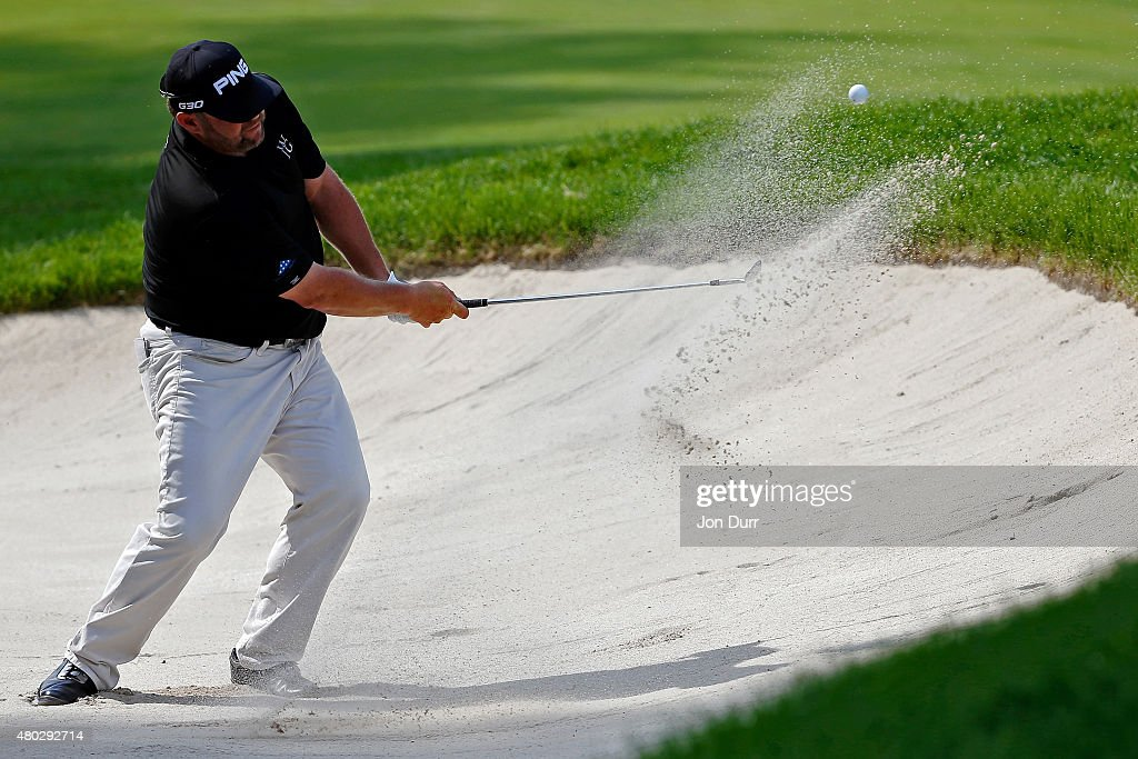 Jason Gore takes a shot from a bunker on the ninth hole during the second round of the John Deere Classic held at TPC Deere Run on July 10, 2015 in Silvis, Illinois.