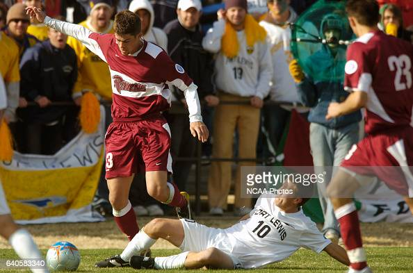 Jason Grier of Franklin Pierce and Casey Roberts of Fort Lewis battle for the ball during the Men's Division II Soccer Championship held on the...