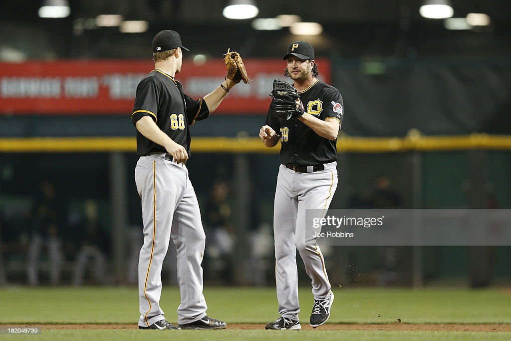 <a gi-track='captionPersonalityLinkClicked' href=/galleries/search?phrase=Jason+Grilli&family=editorial&specificpeople=615724 ng-click='$event.stopPropagation()'>Jason Grilli</a> #39 and <a gi-track='captionPersonalityLinkClicked' href=/galleries/search?phrase=Justin+Morneau&family=editorial&specificpeople=211556 ng-click='$event.stopPropagation()'>Justin Morneau</a> #66 of the Pittsburgh Pirates celebrate after the final out against the Cincinnati Reds during the game at Great American Ball Park on September 27, 2013 in Cincinnati, Ohio. The Pirates won 4-1.