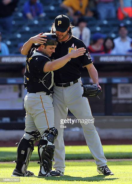 Jason Grilli and Michael McKenry of the Pittsburgh Pirates celebrates the win over the New York Mets on May 12 2013 at Citi Field in the Flushing...