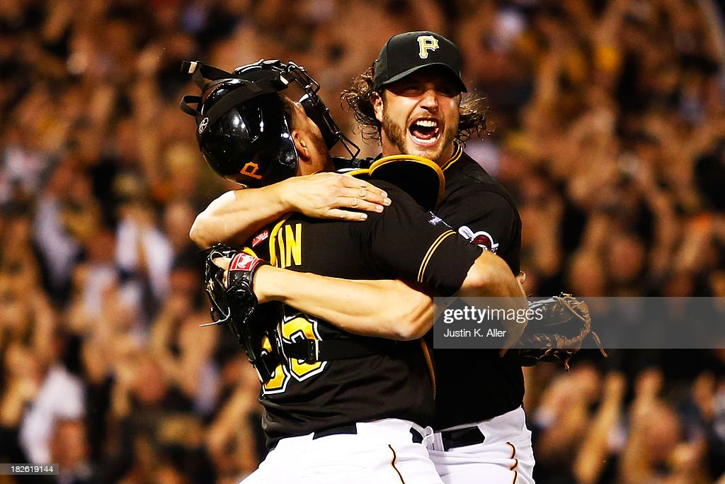 Jason Grilli #39 and Russell Martin #55 of the Pittsburgh Pirates celebrate their 6 to 2 win over the Cincinnati Reds during the National League Wild Card game at PNC Park on October 1, 2013 in Pittsburgh, Pennsylvania.