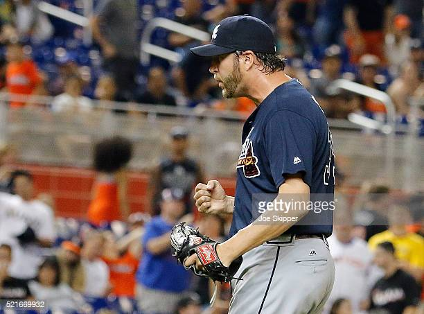 Jason Grilli of the Atlanta Braves celebrates his save after he struck out Giancarlo Stanton of the Miami Marlins to end the game at Marlins Park on...