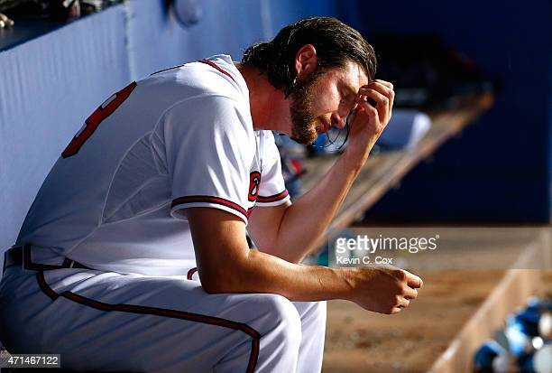 Jason Grilli of the Atlanta Braves reacts in the dugout after giving up a threerun homer and the lead in the top of the ninth to the Washington...