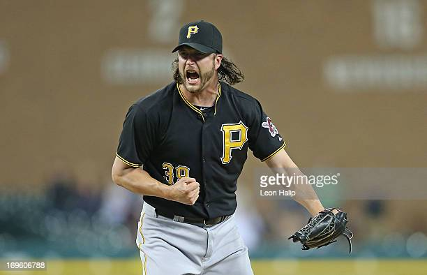 Jason Grilli of the Pittsburgh Pirates celebrates the final out in the eleventh inning during the game against the Detroit Tigers at Comerica Park on...