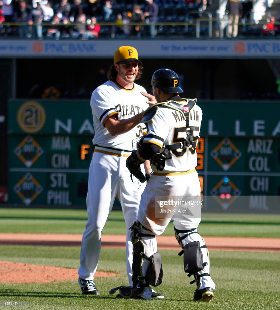 Jason Grilli #39 of the Pittsburgh Pirates celebrates with Russell Martin #55 after closing out the game against the Atlanta Braves during the game on April 21, 2013 at PNC Park in Pittsburgh, Pennsylvania. The Pirates defeated the Braves 4-2.