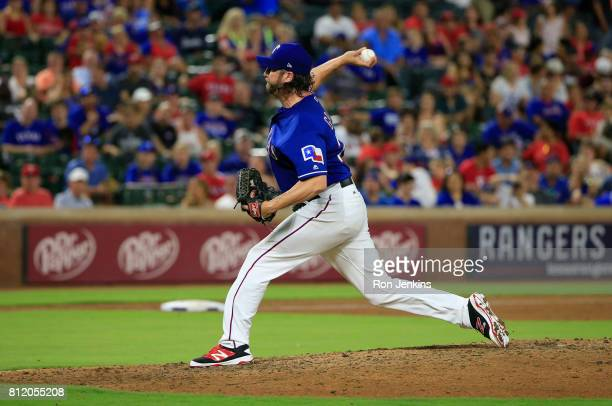 Jason Grilli of the Texas Rangers delivers against the Los Angeles Angels of Anaheim during the ninth inning at Globe Life Park in Arlington on July...