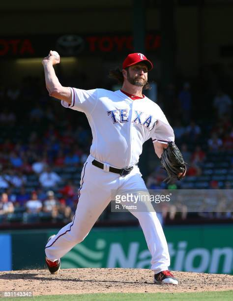 Jason Grilli of the Texas Rangers throws in the ninth inning against the Baltimore Orioles at Globe Life Park in Arlington on July 30 2017 in...
