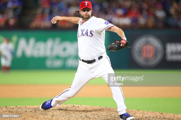 Jason Grilli of the Texas Rangers throws in the seventh inning against the Chicago White Sox at Globe Life Park in Arlington on August 19 2017 in...