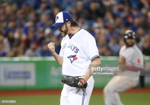 Jason Grilli of the Toronto Blue Jays celebrates after retiring the side in the eighth inning during MLB game action against the Boston Red Sox at...