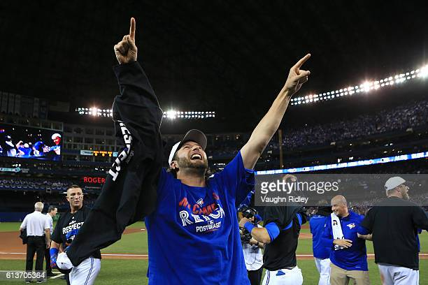 Jason Grilli of the Toronto Blue Jays celebrates after the Toronto Blue Jays defeated the Texas Rangers 76 for game three of the American League...