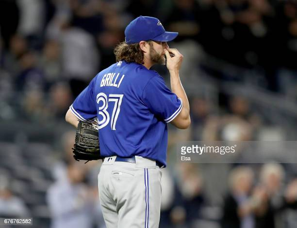 Jason Grilli of the Toronto Blue Jays reacts after giving up a three run home run to Aaron Judge of the New York Yankees in the seventh inning on May...