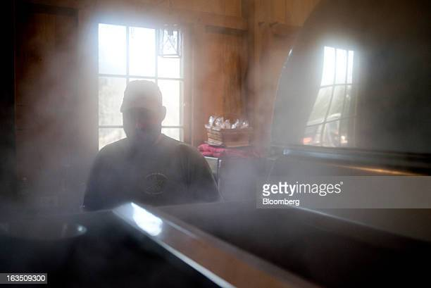 Jason Grossman watches over boiling maple sap in an evaporator during the process of making maple syrup at Grossman Brothers Maple Products in...