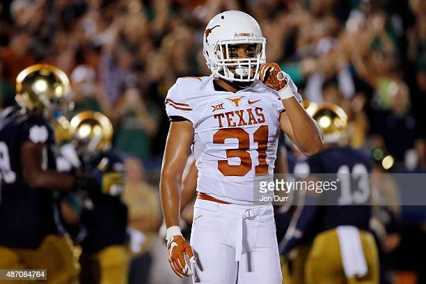 Jason Hall of the Texas Longhorns reacts after a Notre Dame Fighting Irish touchdown during the fourth quarter at Notre Dame Stadium on September 5...