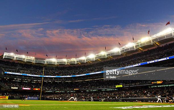 Jason Hammel of the Baltimore Orioles pitches against Nick Swisher of the New York Yankees during Game Five of the American League Division Series at...