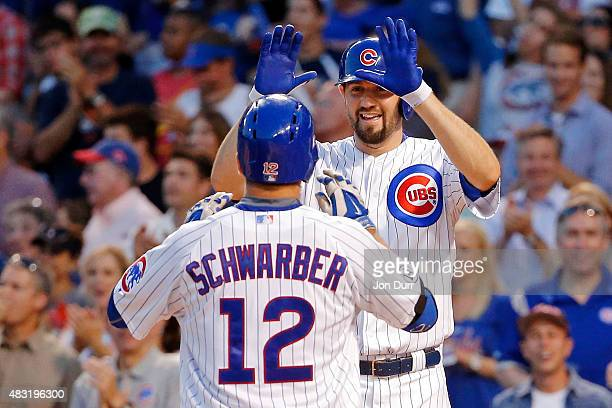 Jason Hammel of the Chicago Cubs congratulates Kyle Schwarber after he hit a three run home run against the San Francisco Giants during the second...