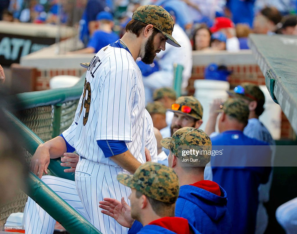 <a gi-track='captionPersonalityLinkClicked' href=/galleries/search?phrase=Jason+Hammel+-+Baseball+Player&family=editorial&specificpeople=7902991 ng-click='$event.stopPropagation()'>Jason Hammel</a> #39 of the Chicago Cubs into the dugout after being taken out of the game before the start of the third inning due to an injury during the game against the Los Angeles Dodgers at Wrigley Field on May 30, 2016 in Chicago, Illinois.