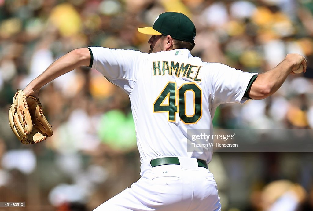 Jason Hammel #40 of the Oakland Athletics pitches against the Seattle Mariners in the top of the first inning at O.co Coliseum on September 1, 2014 in Oakland, California.