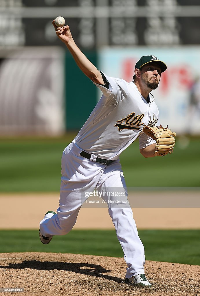 Jason Hammel #40 of the Oakland Athletics pitches against the Seattle Mariners in the top of the eighth inning at O.co Coliseum on September 1, 2014 in Oakland, California. The Athletics won the game 6-1.