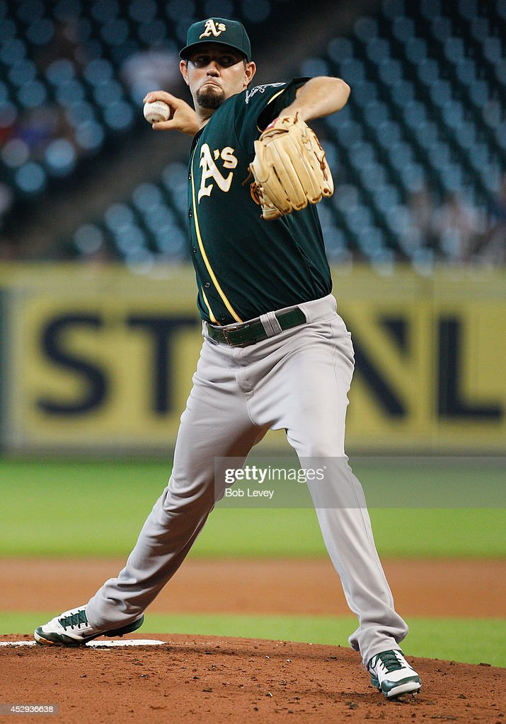 Jason Hammel #40 of the Oakland Athletics throws in the first inning against the Houston Astros at Minute Maid Park on July 30, 2014 in Houston, Texas.