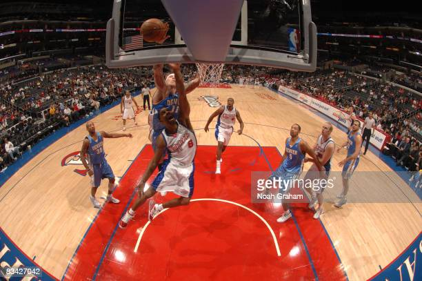 Jason Hart of the Los Angeles Clippers has his shot blocked by Chris Andersen of the Denver Nuggets at Staples Center on October 24 2008 in Los...