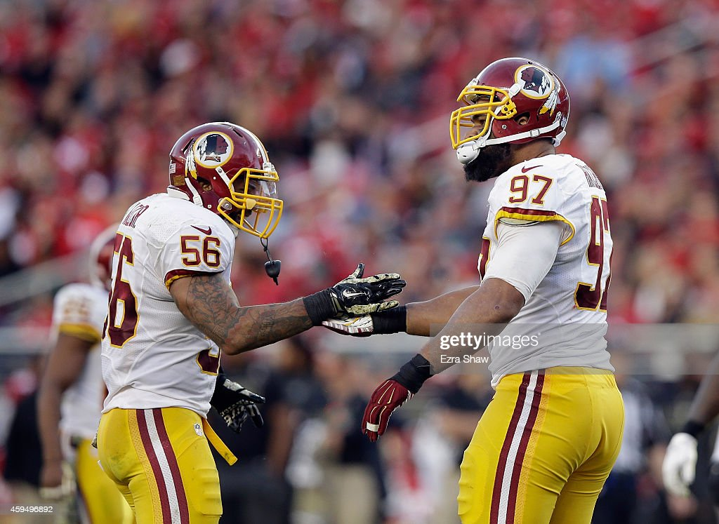 Jason Hatcher and Perry Riley of the Washington Redskins celebrate after Hatcher sacked Colin Kaepernick of the San Francisco 49ers at Levi's Stadium...