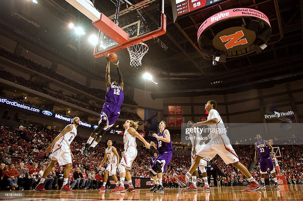 Jason Hawthorne #12 of the Western Illinois Leathernecks drives to the hoop against the Nebraska Cornhuskers defense during their game at Pinnacle Bank Arena on November 12, 2013 in Lincoln, Nebraska.