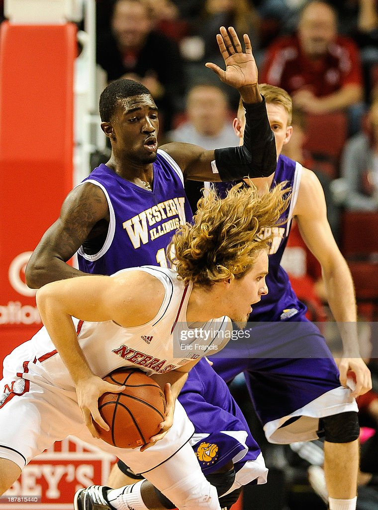 Jason Hawthorne #12 of the Western Illinois Leathernecks guards Mike Peltz #12 of the Nebraska Cornhuskers during their game at Pinnacle Bank Arena on November 12, 2013 in Lincoln, Nebraska.