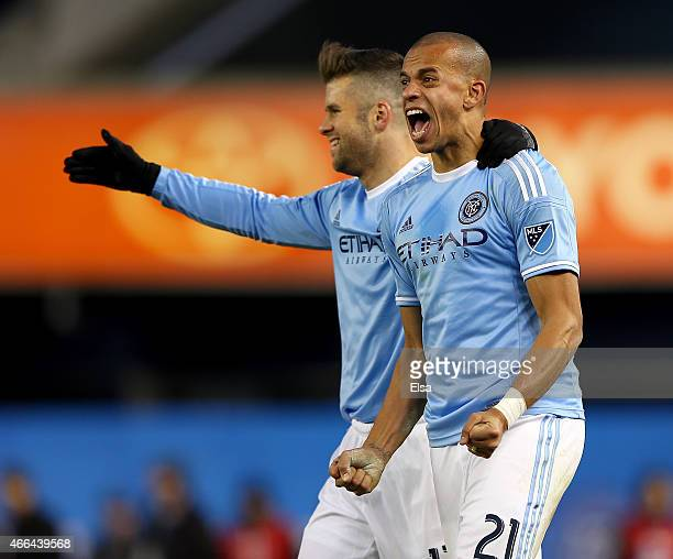 Jason Hernandez and Chris Wingert of New York City FC celebrate the win after the inaugural game of the New York City FC at Yankee Stadium on March...