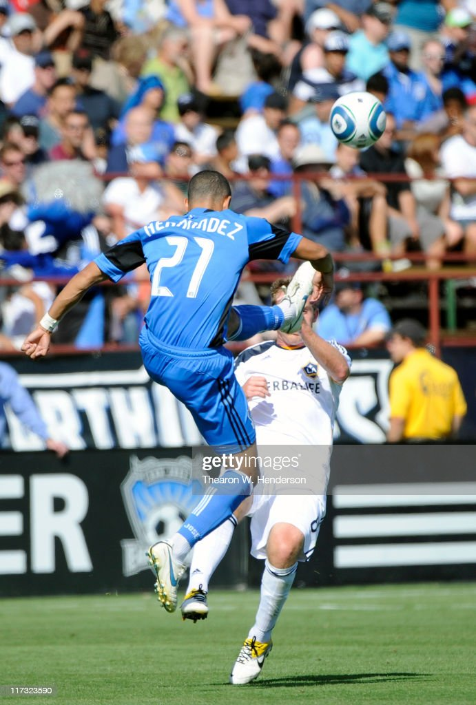 Jason Hernandez of the San Jose Earthquakes kicks the ball away from Chris Birchall of the Los Angeles Galaxy during an MLS soccer game at Buck Shaw...