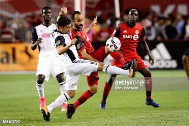 Jason Hernandez of Toronto FC and Alejandro Bedoya of Philadelphia Union battle for the ball during the second half of the MLS Soccer regular season...