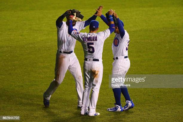 Jason Heyward Albert Almora Jr #5 and Jon Jay of the Chicago Cubs celebrate after beating the Los Angeles Dodgers 32 in game four of the National...