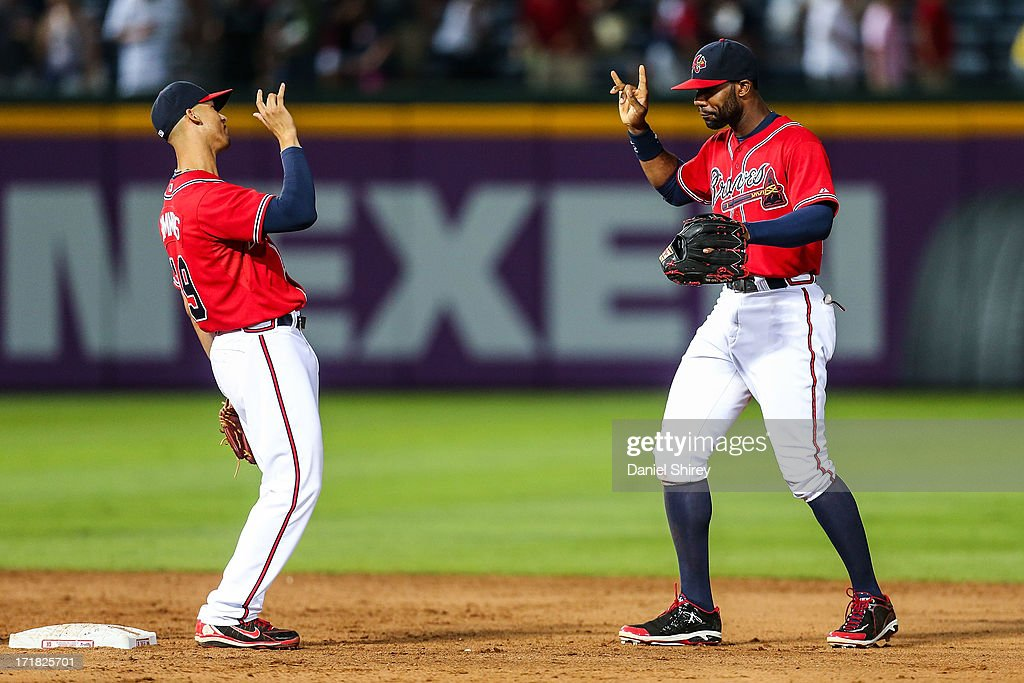 <a gi-track='captionPersonalityLinkClicked' href=/galleries/search?phrase=Jason+Heyward&family=editorial&specificpeople=5043351 ng-click='$event.stopPropagation()'>Jason Heyward</a> #22 and <a gi-track='captionPersonalityLinkClicked' href=/galleries/search?phrase=Andrelton+Simmons&family=editorial&specificpeople=8978424 ng-click='$event.stopPropagation()'>Andrelton Simmons</a> #19 of the Atlanta Braves celebrate winning against the Arizona Diamondbacks at Turner Field on June 28, 2013 in Atlanta, Georgia. The Braves won 3-0.